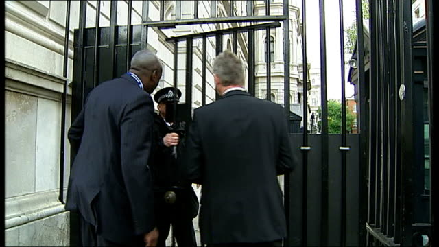 Liam Fox and Ken Clarke arrive at Downing Street ENGLAND London Downing Street EXT Dr Liam Fox arriving at Downing Street as away thru gates / Crowd...