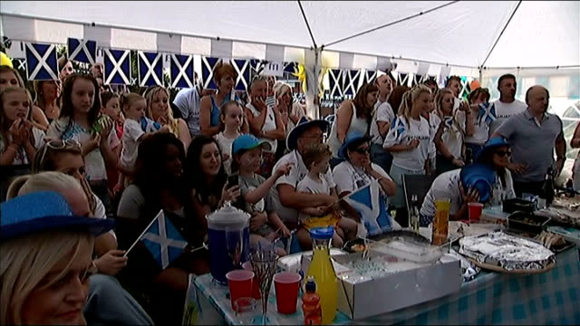 stockvideo's en b-roll-footage met first day of competition; location unknown: friends and family of michael jamieson watching race and cheering at street party sot - itv