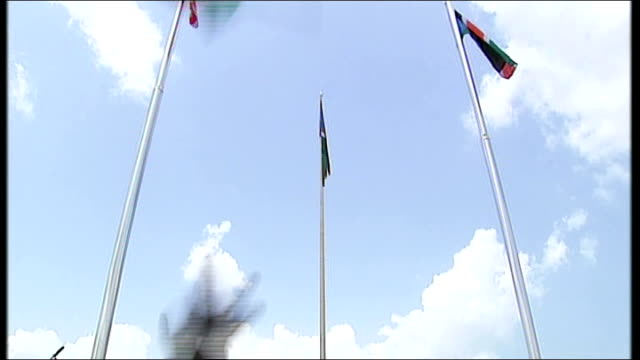 first day of independence celebrated flag of sudan being lowered new flag of south sudan being raised to cheers sot crowd of people cheering woman... - independence stock videos & royalty-free footage