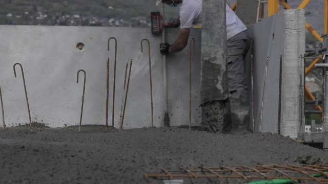first day of work on a construction site during the lockdown with new hygiene measures linked to the fight against the coronavirus on april 16, 2020... - クラシファイド広告点の映像素材/bロール