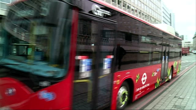 London EXT Red double decker buses along on road Arriva bus along Passengers onto bus Close shot exhaust of bus Electric bus towards along road view...