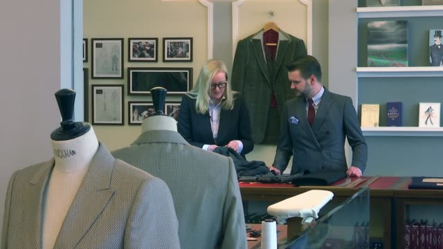first female master tailor opens shop on savile row int sargent and unidentified man working in shop - savile row stock videos and b-roll footage