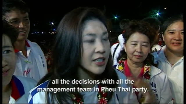 first female prime minister elected; 2.7.2011 thailand: bangkok: ext / night yingluck shinawatra along through supporters yingluck shinawatra... - prime minister stock videos & royalty-free footage
