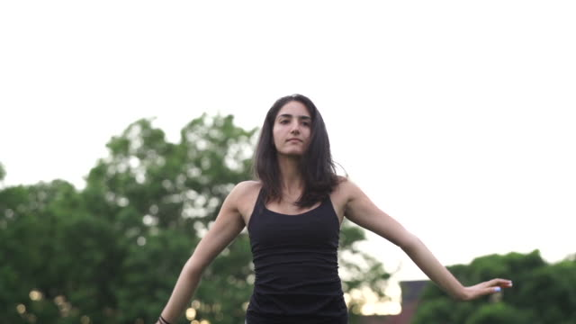stockvideo's en b-roll-footage met a first generation, middle-eastern woman practices yoga - menselijke ledematen