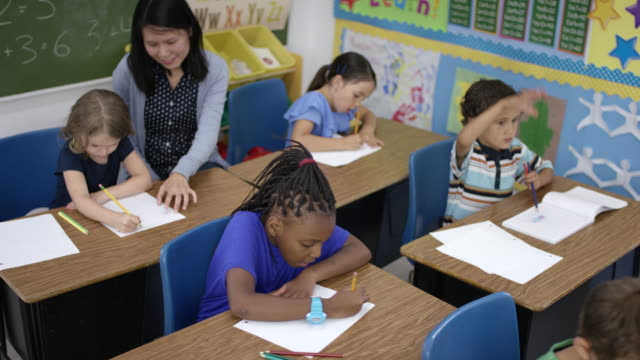 First grade students studying at their desks