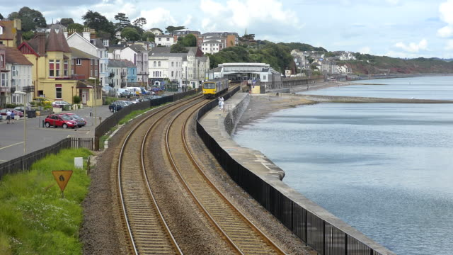 a first great western local diesel passenger train traveling along the seawall railway tracks at dawlish. - devon stock videos & royalty-free footage
