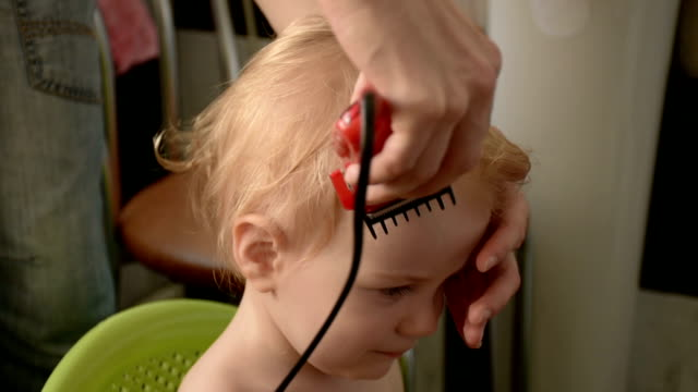 first haircut of little baby boy - cutting hair stock videos and b-roll footage
