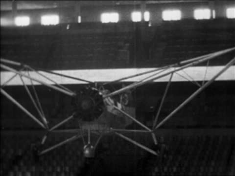 b/w 1937 first helicopter (focke achgelis fa 61) hovering in berlin stadium, germany / industrial - 1937 stock videos & royalty-free footage