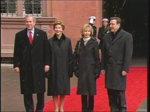 of first ladies laura bush and doris schroeder walking to meet president george w bush and chancellor gerhard schroeder. they stand together outside... - laura bush stock videos & royalty-free footage