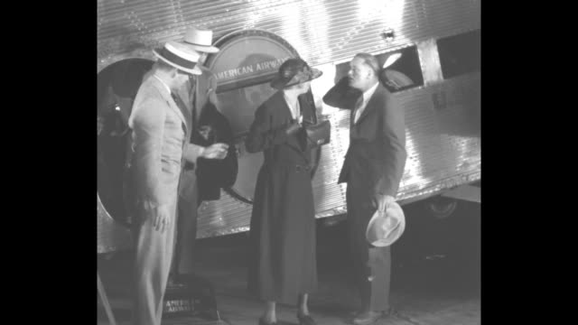 MS First Lady Eleanor Roosevelt deplanes with son Elliott Roosevelt / MS Eleanor makes statement at microphones American Airways plane behind her /...
