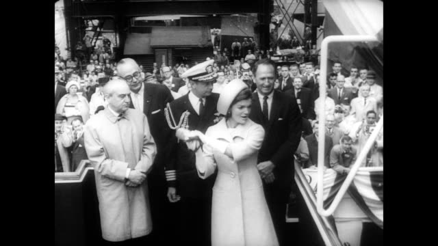 / first lady jackie kennedy walks past a large crowd at the docks on her way to christen a new submarine / cu nose of the submarine / huge crowd... - groton connecticut stock videos & royalty-free footage