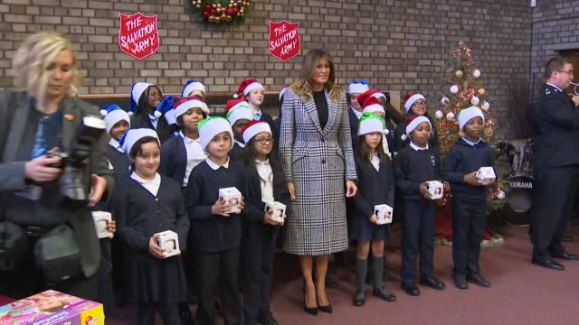 first lady melania trump poses for class photo with schoolchildren at salvation army event, london - salvation army stock videos & royalty-free footage