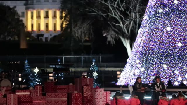 stockvideo's en b-roll-footage met first lady michelle obama and olympic medalist simone manuel read a christmas story to kids at the 94th annual national christmas tree lighting... - ellips