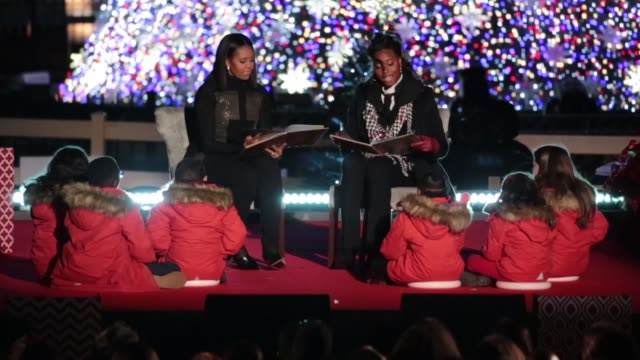 first lady michelle obama and olympic medalist simone manuel read a christmas story to kids at the 94th annual national christmas tree lighting... - christmas tree lighting ceremony stock videos & royalty-free footage