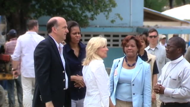 first lady michelle obama and wife of vice president jill biden visit haiti; 13 april 2010 - first lady stock videos & royalty-free footage