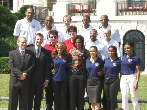 first lady michelle obama poses for a group photo with the members of the president's council on fitness, sports and nutrition at white house event... - ビリー・ジーン・キング点の映像素材/bロール
