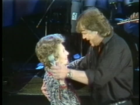 first lady nancy reagan dances with swedish singer lasse berghagen at a concert in stockholm. - music or celebrities or fashion or film industry or film premiere or youth culture or novelty item or vacations stock videos & royalty-free footage