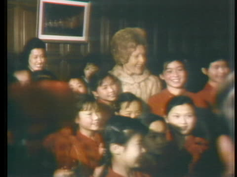first lady pat nixon meets with chinese children and women after a children's ballet performance during the nixons' historic visit to china. - business or economy or employment and labor or financial market or finance or agriculture stock videos & royalty-free footage