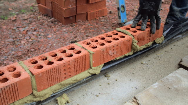 first layer of bricks in place - construction site stock videos & royalty-free footage