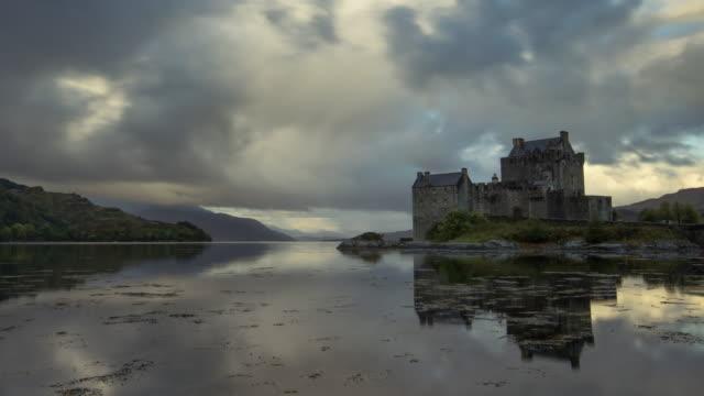 first light over eilean donan castle on loch duich in the scotish highlands - loch duich stock videos & royalty-free footage