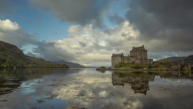 first light over eilean donan castle on loch duich in the scotish highlands - scottish culture bildbanksvideor och videomaterial från bakom kulisserna