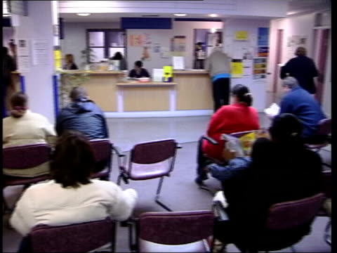 First major cold virus of the year People sitting in doctor's waiting area PAN reception People sitting in clinic waiting area