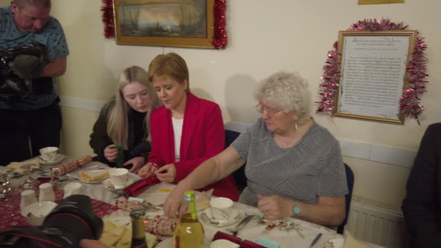 first minister nicola sturgeon and snp candidate in east dunbartonshire amy callaghan attend a pensioners christmas dinner at the fraser centre on... - 10 11 years stock videos & royalty-free footage