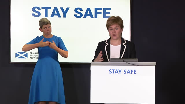 """first minister of scotland nicola sturgeon saying many """"baseline measures"""" for coronavirus will """"still be in place for some time yet"""" - safety stock videos & royalty-free footage"""