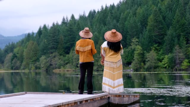 first nations woman blessing and singing by the lake - traditionally canadian stock videos & royalty-free footage