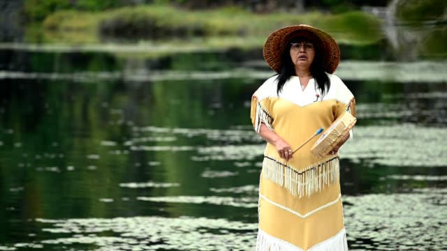 first nations woman performing a welcome song - north american tribal culture stock videos & royalty-free footage