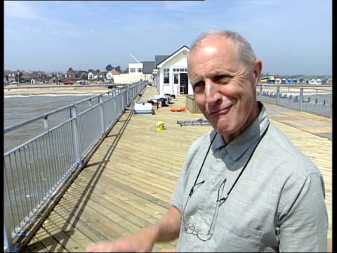 first new pier for 40 years itn southwold view of beach from pier pan brian haward interview sot talks of attitude towards the pier nick haward... - shack stock videos & royalty-free footage
