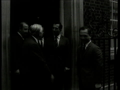 first 'news at ten' broadcast on itv london downing street ext harold wilson mp greeting king hussein of jordan wilson and king hussein of jordan... - harold wilson stock-videos und b-roll-filmmaterial