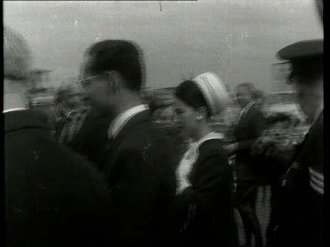 first 'news at ten' broadcast on itv london heathrow king bhumibol adulyadej and queen sirikit of thailand along at airport and being presented with... - itv news at ten stock videos & royalty-free footage