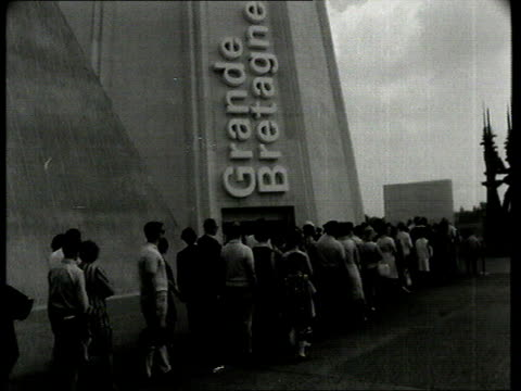 first 'news at ten' broadcast on itv report on british pavillion at expo 67 in canada by john whale various of british pavilion two girls rl to bv in... - itv news at ten stock videos & royalty-free footage