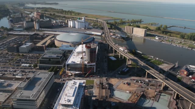 first niagara center arena stands past harbor center under construction in buffalo, new york, us, traffic moves on the buffalo skyway in buffalo, new... - buffalo new york state stock videos & royalty-free footage