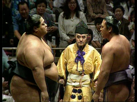 First official overseas contest to be held in London JAPAN Tokyo TMS Sumo wrestlers in ring taking part in ceremony ZOOM IN TMS Sumo wrestler and...