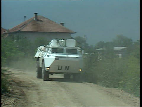 First overall ceasefire takes effect ITN LIB UN lorry apc along road UN flag flying atop building