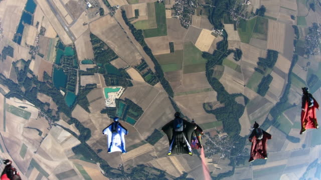 first person camera view of a group of wing suit fliers above slovenia - digital camcorder stock videos & royalty-free footage