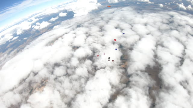 first person camera view of a group of wing suit fliers above slovenia - moving down stock videos & royalty-free footage
