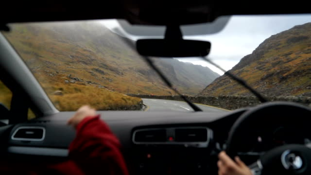 first person perspective driving through highland environment on the way to begin a hike - snowdonia stock videos & royalty-free footage