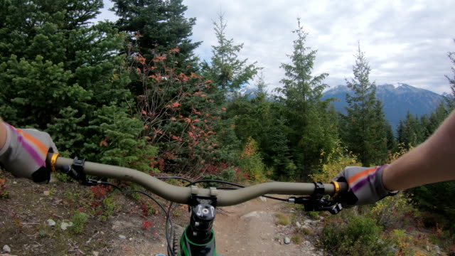 first person perspective mountain biking down rugged path - direction stock videos & royalty-free footage