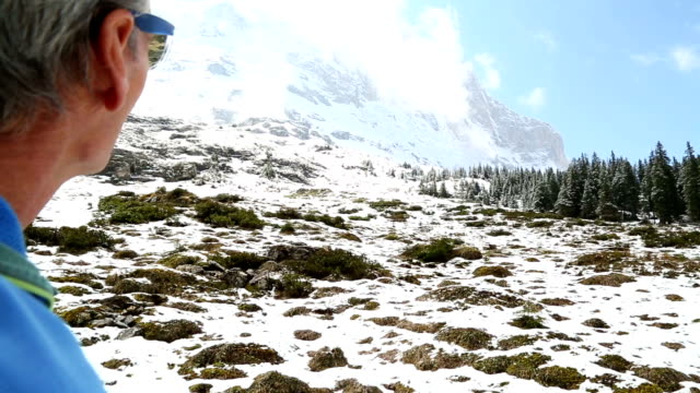 first person perspective of a man hiking in the european alps - only mature men stock videos & royalty-free footage