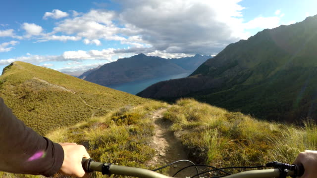 first person perspective of mountain biker descending picturesque ridge line - scenics stock videos & royalty-free footage