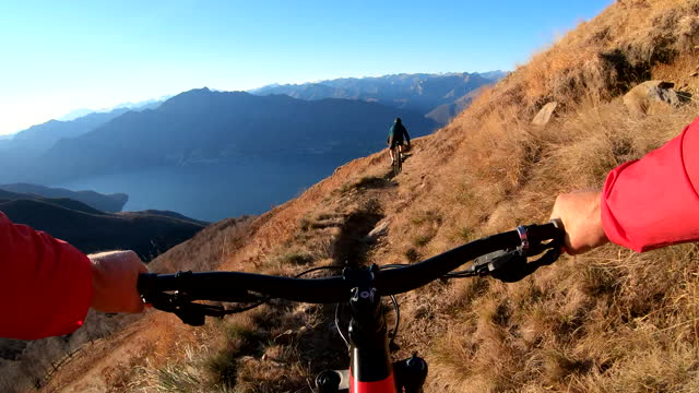 first person perspective of mountain biking along top of a mountain at sunrise - escapism stock videos & royalty-free footage