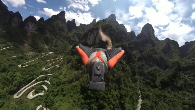 first person perspective of wing suit flying, 360º camera - exhilaration stock videos & royalty-free footage