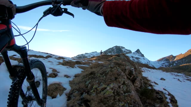 first person perspective pushing mountain bike up snowy mountain meadow - cold temperature stock videos & royalty-free footage