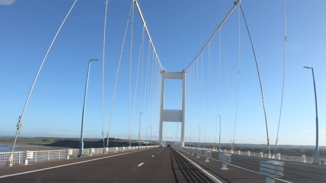 first person view as a car drives over the border from wales to england on the m48 via the severn bridge on november 4, 2020 in bristol, england.... - major road stock videos & royalty-free footage
