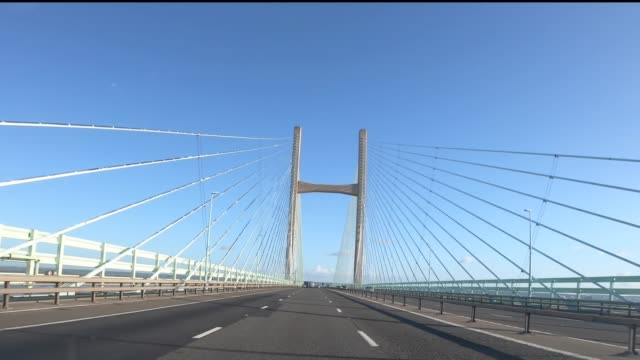 first person view as a car drives over the border from wales to england on the m4 via the prince of wales bridge, formerly the second severn... - remote control stock videos & royalty-free footage