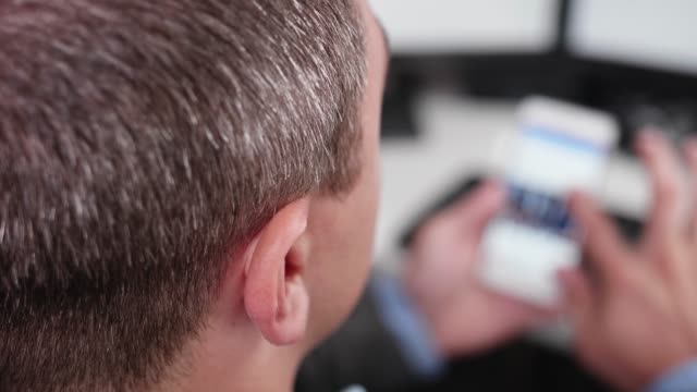 first person view of a business person scrolling social media on his smart phone - scrolling stock videos & royalty-free footage