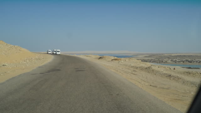 first person view of driving in the desert near cairo - middle east stock videos & royalty-free footage